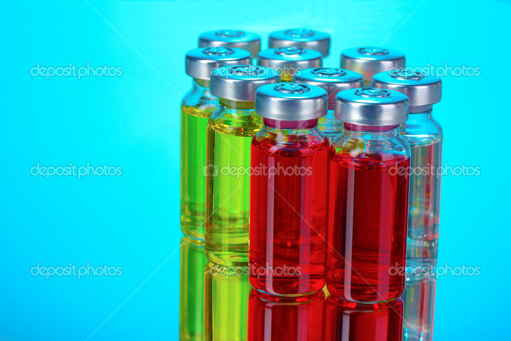 Medical ampoules on blue background — Foto Stock #6798297