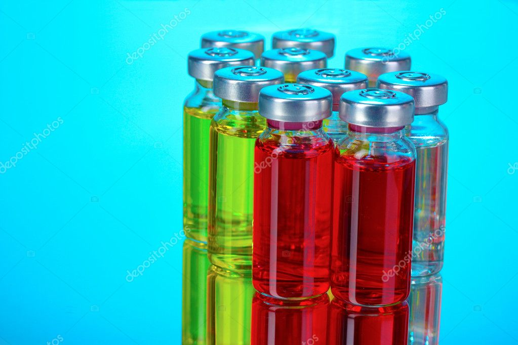 Medical ampoules on blue background — Stok fotoğraf #6798297