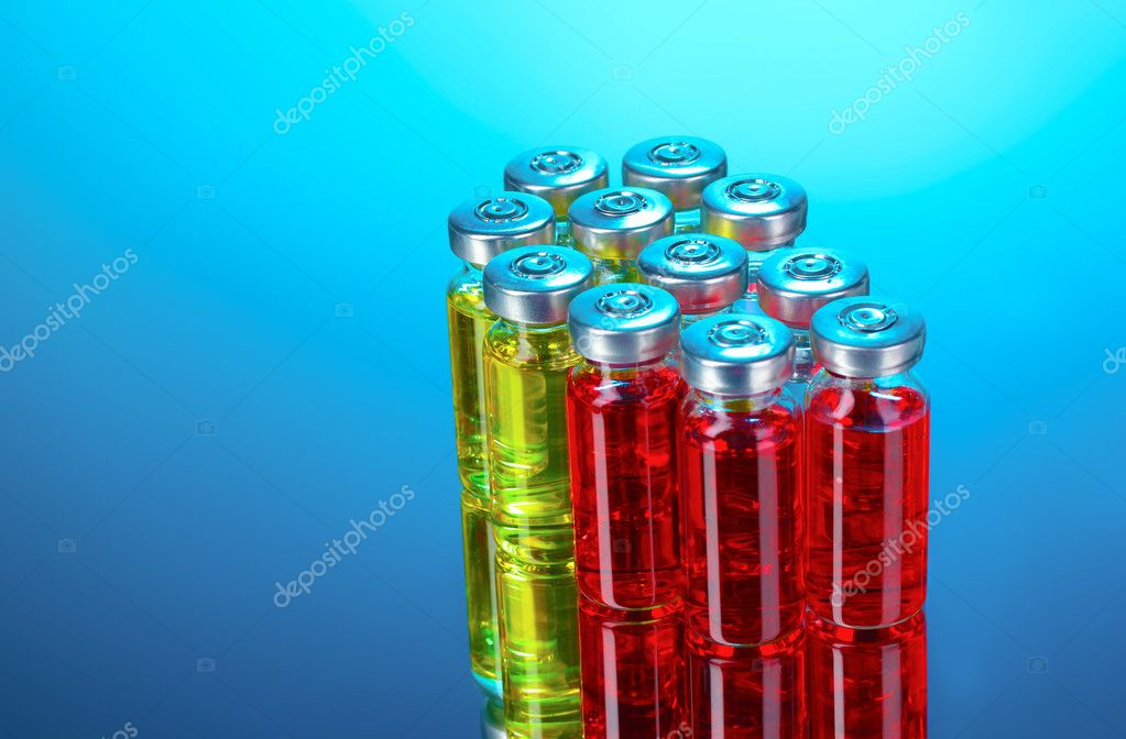 Medical ampoules on blue background  Stock Photo #6798304