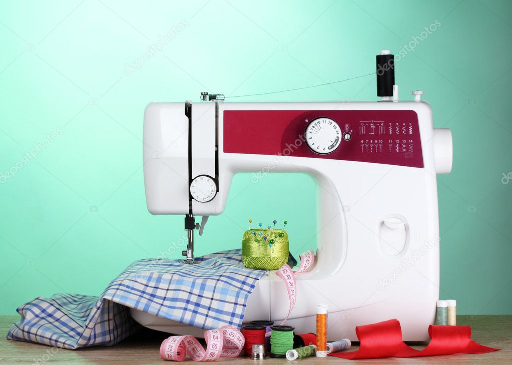 Sewing machine and fabric on green background — Stock Photo #6798884