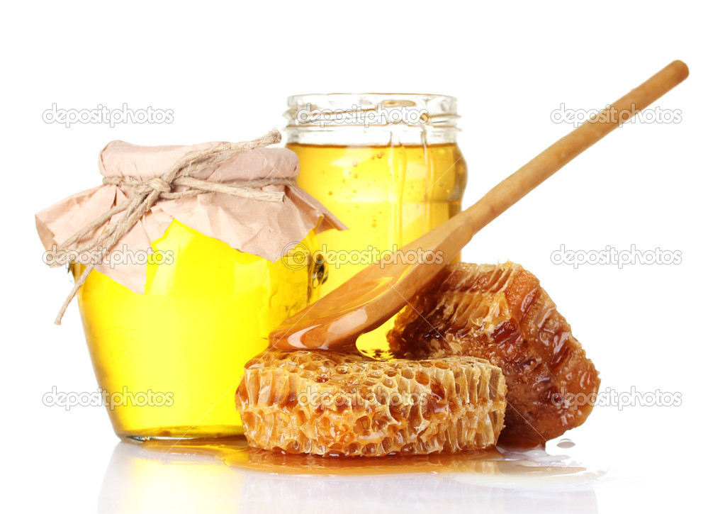 Beautiful combs, spoon and honey in jar isolated on white — Stock Photo #6799094