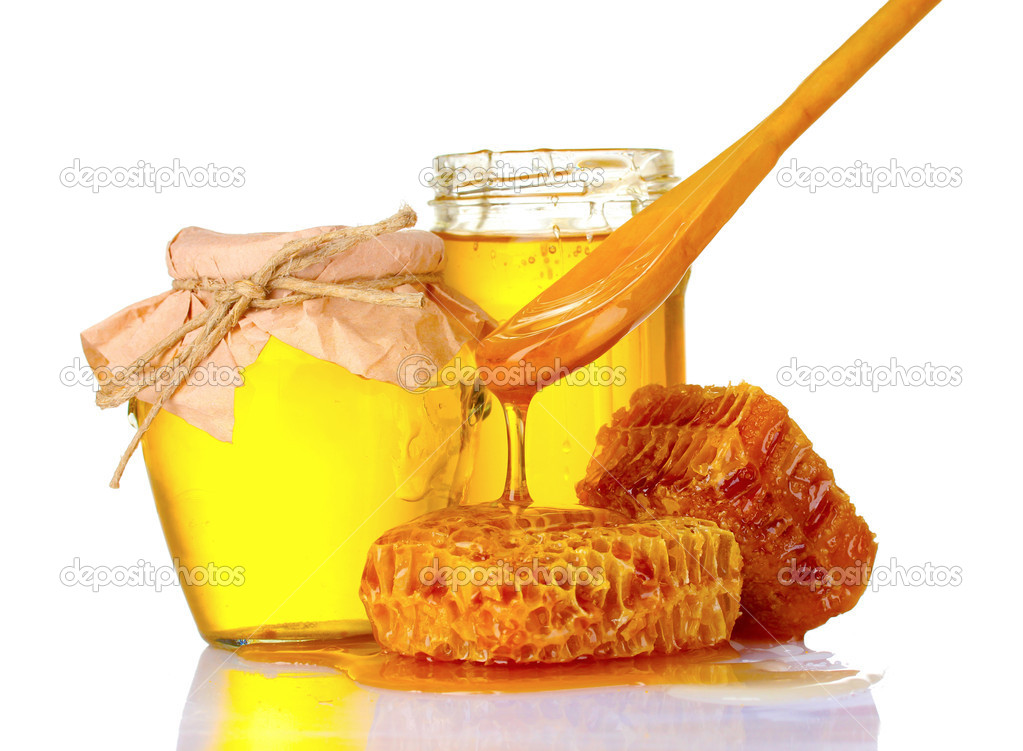 Beautiful combs, spoon and honey in jar isolated on white  Stock Photo #6799110
