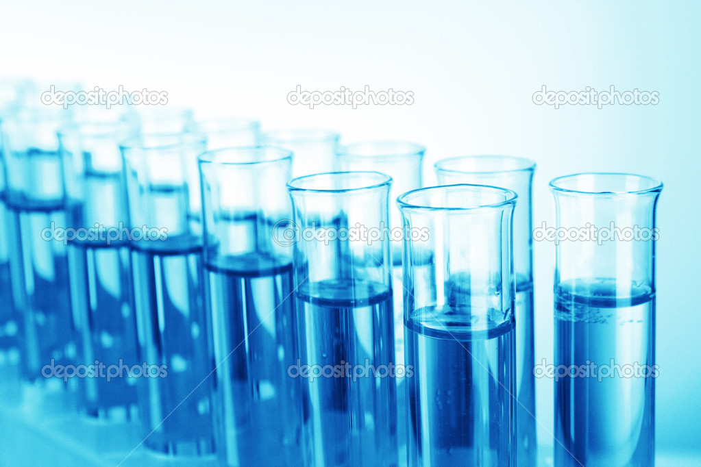 Test-tubes on blue background — Stock Photo #6799138