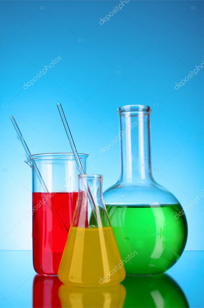 Laboratory glassware on blue background — Stock Photo #6799216