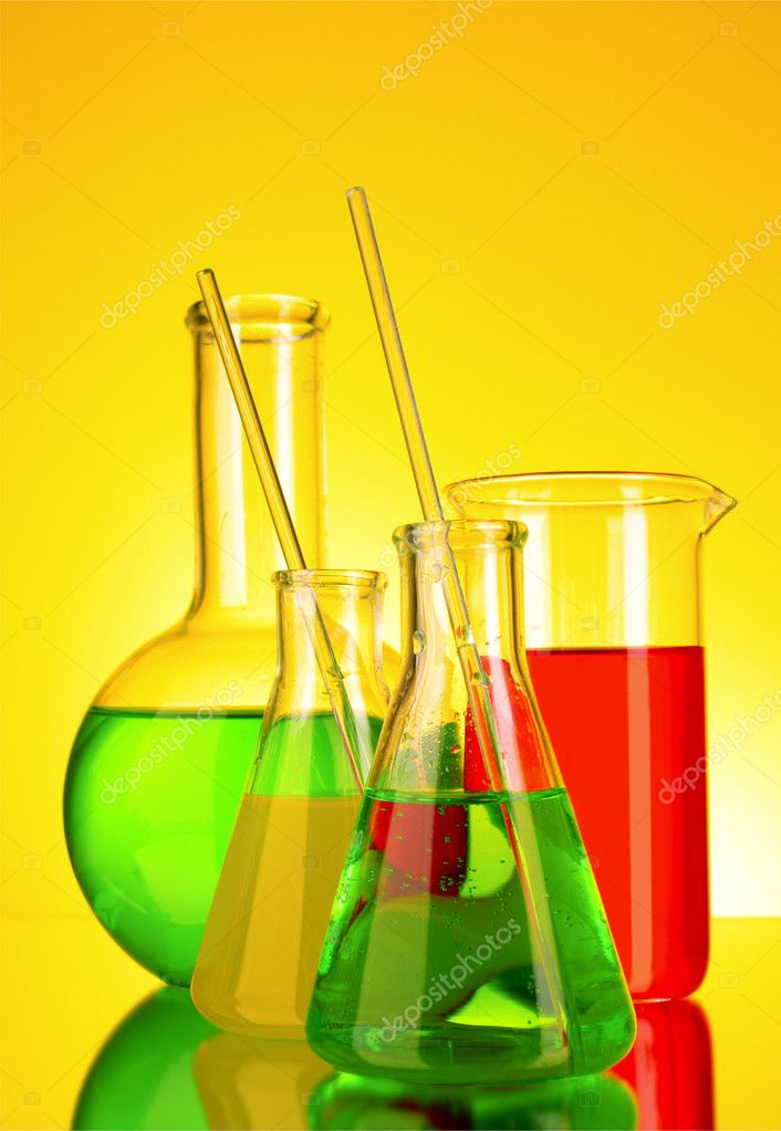 Laboratory glassware on yellow background — Stock Photo #6799242
