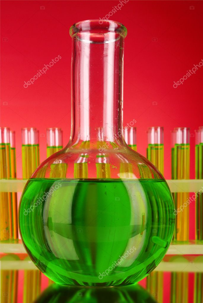 Flask on test-tubes background — Stock Photo #6799260