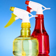 Two spray bottles on blue background — Stock Photo