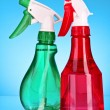 Two spray bottles on blue background — Stock Photo #6800011