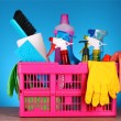 Cleaning supplies in basket on blue background — Stock Photo #6800016