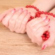 Beads in hand — Stock Photo