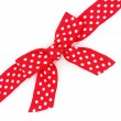 Dotted red ribbon and bow isolated on white background - Foto de Stock