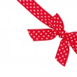 Dotted red ribbon and bow isolated on white background — Stock Photo #6800252