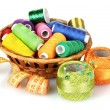 Bright threads in basket and measuring tape — Stock Photo #6801069