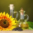 Sunflower oil and sunflower - Stock Photo