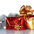 Beautiful gifts with gold bows and Christmas ball - Stock fotografie