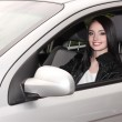 Young brunette woman with keys to new car — Stock Photo #6803085