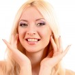 Young beautiful smiling blond woman touching her face isolated o — Stock Photo