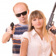 Man and woman with guns isolated on white — Stock Photo
