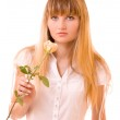 Beautiful young woman with flower over white — Stock Photo