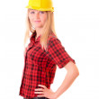 Young woman with yellow helmet isolated on white — Stock Photo