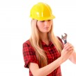 Young woman in helmet with adjustable wrench isolated on white — Stock Photo #6805487