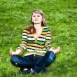 Young woman doing yoga in park — Stock Photo #6805540