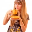 Young woman drink tea from cup isolated on white — Stock Photo