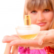 Young woman with perfume bottle — Stock Photo