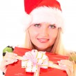 Young woman with christmas hat and gift isolated on white — Stock Photo #6805897