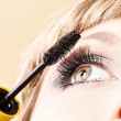 Stock Photo: Young woman makeup with mascara eye closeup