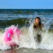 Young woman in storm in sea — Stock Photo