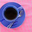 Royalty-Free Stock Photo: Blue cup of tea on the the table