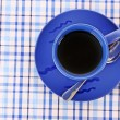 Blue cup of tea on the the table — Stock Photo