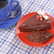 Slice of chocolate cake and cup of tea — Stock Photo