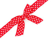 Dotted red ribbon and bow isolated on white background — Stock Photo