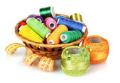 Bright threads in basket and measuring tape — Stock Photo