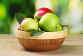 Fresh organic apples in plate — Stock Photo