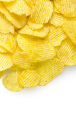 Delicious potato chips isolated on white — Stock Photo
