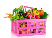A set of vegetables in plastic basket isolated on white — Stock Photo