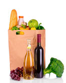 Vegetables and wine in a paper bag — Stock Photo