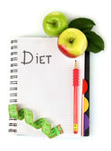 Planning of a diet. Notebook, pencil and fresh apples — Stock Photo