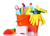 Detergent bottles, brushes and sponges in bucket — Stock Photo