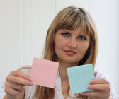 Girl with blank note pads — Stock Photo