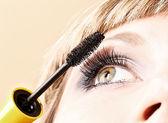 Young woman makeup with mascara eye closeup — Stock Photo