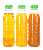 Bottles of juice on a white background — Stock Photo