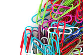 Paper clips on white background — Stock Photo