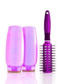 Shampoo bottles and hair brush on white — Stock Photo