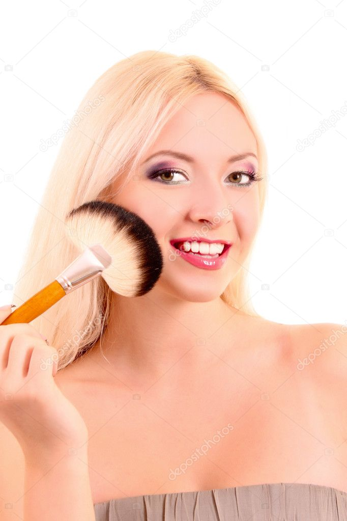 Young beautiful woman with brush for make-up isolated on white  Stock Photo #6803418