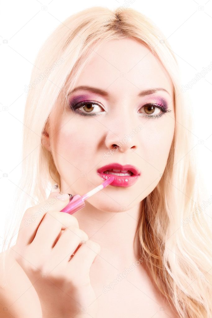 Young beautiful blond woman with pink lipstick isolated on white  Stock Photo #6803421