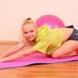 Young beautiful fitness girl with pink ball exercising in the gy — Stock Photo